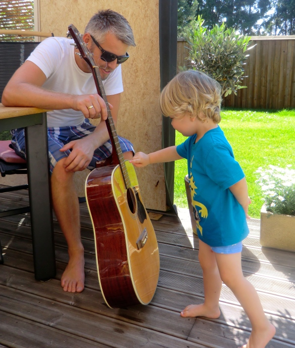 Per Christian gets his first guitar from Uncle C.